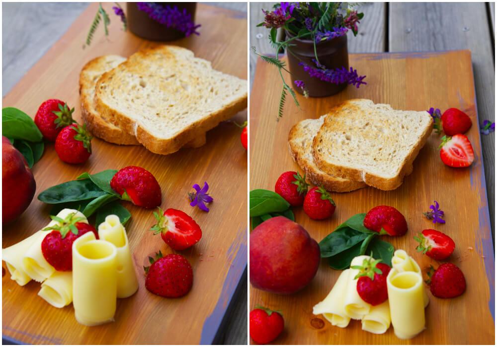 frukostbricka med rostat bröd, ost och jordgubbar